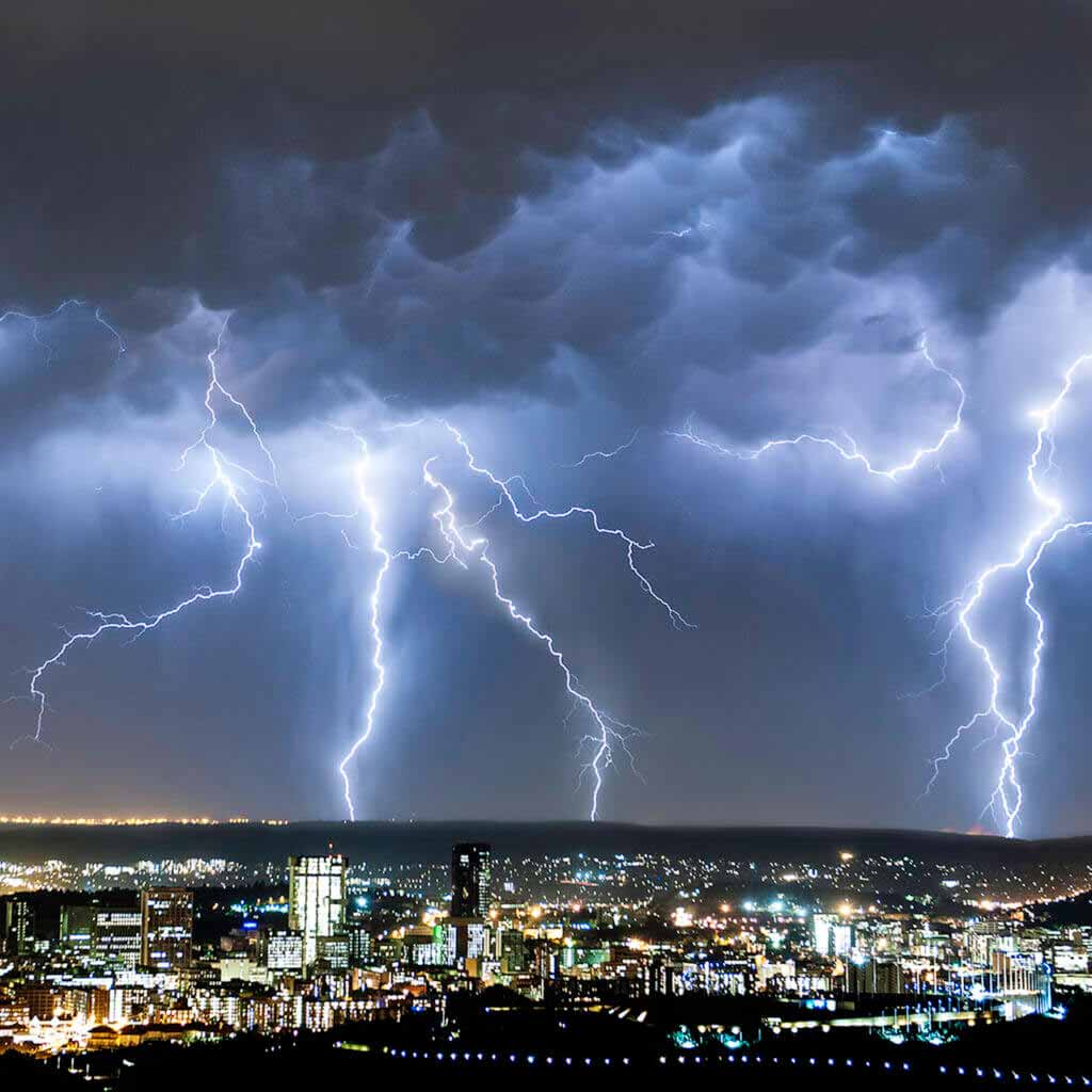 A massive summer thunderstorm with multiple lightning strikes dwarfs the city of Pretoria on a hot summers night. Pretoria is a city and administrative capital of the South Africa. Founded in 1855, it became the capital of the Transvaal in 1860. Pretoria is situated in the northern part of Gauteng Province, South Africa. It is one of the countrys three capital cities, serving as the seat of the executive branch of government. Pretoria has a reputation for being an academic city with three universities and the Council for Scientific and Industrial Research (CSIR) located in its eastern suburbs. Pretoria is named after the Voortrekker leader Andries Pretorius, and within South Africa is popularly known as the Jacaranda City due to the thousands of Jacaranda trees planted in its streets, parks and gardens.