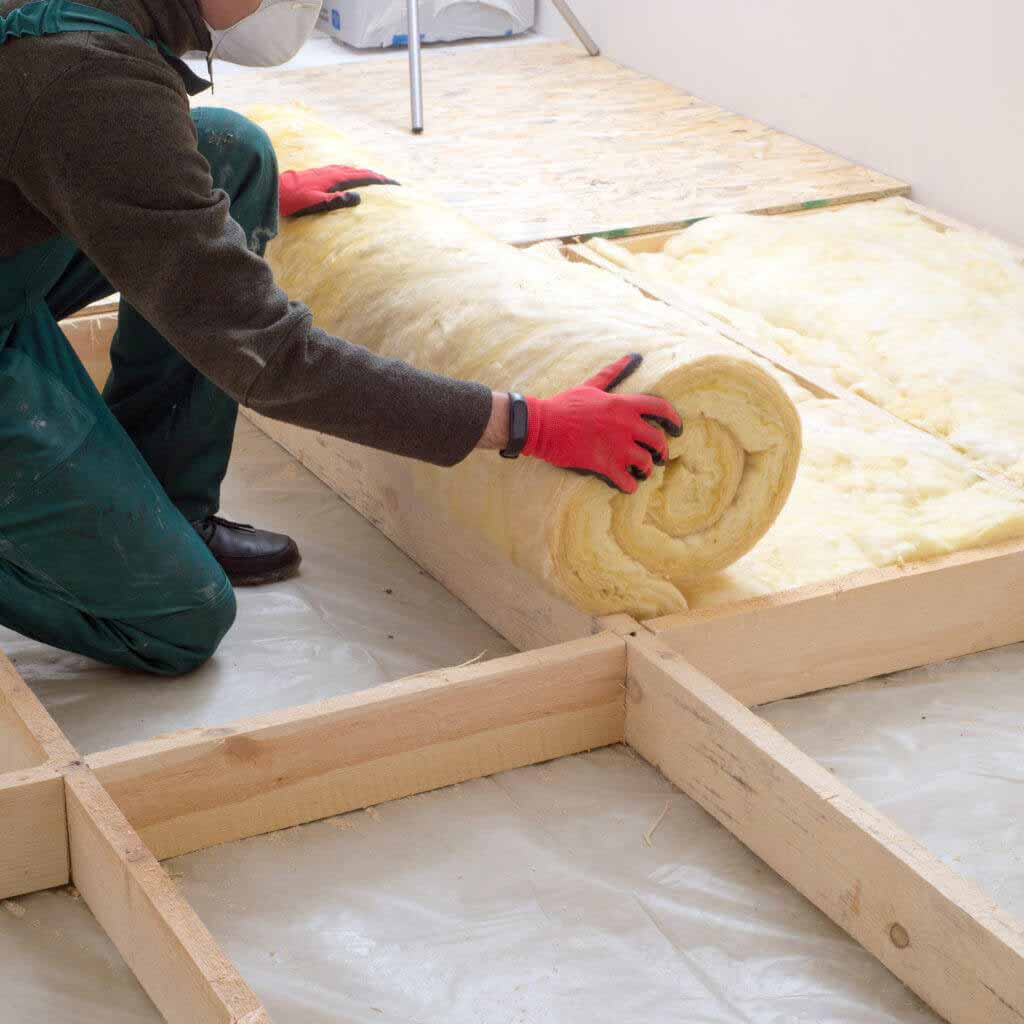 Caucasian,Construction,Worker,With,Roll,Of,Insulating,Material,,Floor,Insulating